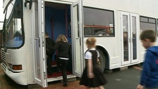 Children from Central First School in Ashington boarding a bus that has been converted into classrooms