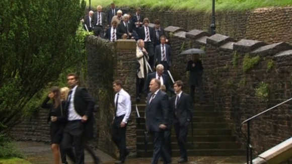 Mourners going to funeral service