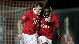Bristol City's Jay Emmanuel-Thomas celebrates scoring their first goal with Aden Flint