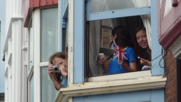 People getting ready to take pictures of the Olympic Torch in Cromer