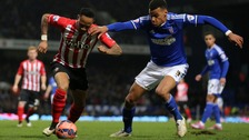 Ipswich Town's Tyrone Mings is challenged by Southampton's Nathaniel Clyne during the FA Cup Third Round replay at Portman Road, Ipswich.