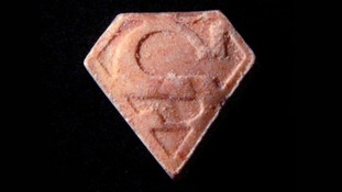 Police urged the public not to take the red pills which have a Superman logo on.