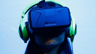 A woman tries out the Oculus Rift virtual reality headset.