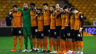Wolves' players observing a minute's silence on Tuesday, just hours after hearing the news of Sir Jack's death