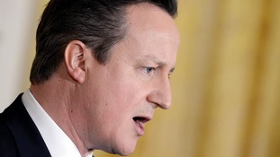 Cameron: Firms should pass on oil price savings to staff.