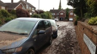 Car covered in mud after the flash flooding in Southwell in July 2013