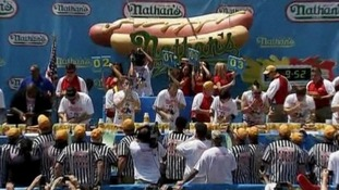 Competitors take part in the international hotdog eating championships.