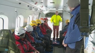 mountain rescue volunteers inside the helicopter