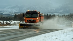 Snow ploughs have been clearing major roads in Cumbria after heavy snowfall.