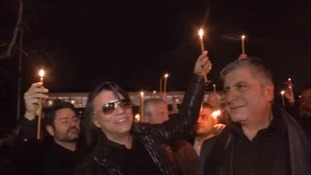 The Mayor of Athens suburb Marathon (centre) joins the vigil