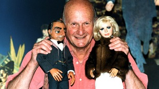 The Creator of the TV show 'Thunderbirds' Gerry Anderson with his most famous puppets, Lady Penelope and Parker