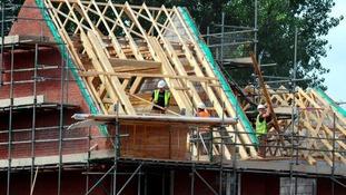 Builders working on a housing development.