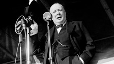 Prime Minister Winston Churchill addresses an audience of more than 20,000 at Walthamstow Stadium, London in 1945.