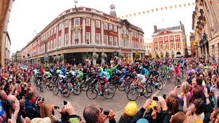 Le Tour De France navigates it's way through York passing Bettys Tea Rooms and the Mansion House.