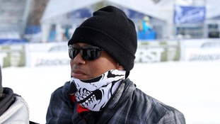Tiger Woods attends the women's Super-G alpine skiing race in Cortina D'Ampezzo