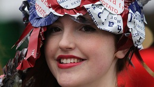 Racegoer models  headpiece made from recycled crisp packets