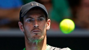 Andy Murray watches the ball as he hits a return to Marinko Matosevic