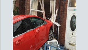 Car crashed into house