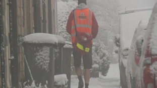 The snow holds no fear for this postman who decided to brave the snow in his shorts.