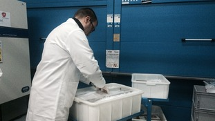 Experts carefully pack the vaccine with dry ice before it is shipped out.