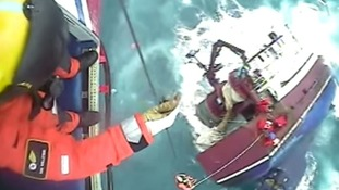 Dramatic footage of rescue at sea moments before boat sinks