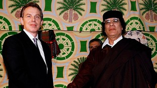 Tony Blair and then Libyan leader Muammar Gaddafi in 2004