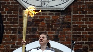 Emily Rogers is the day's first torchbearer