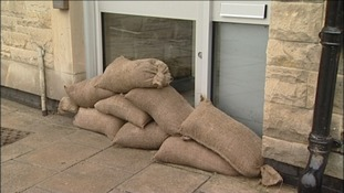 Sandbags block doorways