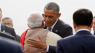 Barack Obama hugs India's Prime Minister Narendra Modi on arrival in New Delhi