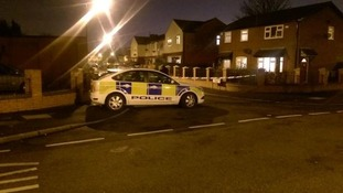 A police car at the scene last night.