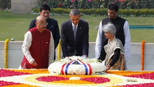 Obama places a wreath at the Mahatma Gandhi memorial at Rajghat in New Delhi.