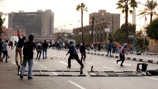 Anti-government protesters throw stones