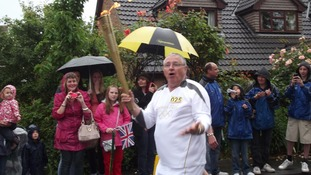 Lisa Bearse sent us this rainy picture of the Olympic Torch