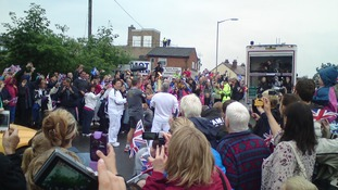 Crowds taking pictures of the Olympic Torch as it heads through Heybridge, Essex