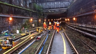 Network Rail engineers at work pumping out the tunnel.