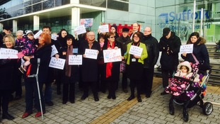 The protest on the steps of Suffolk County Council's offices