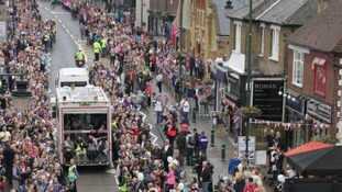 Around 30,000 spectators welcomed Torchbearers from the Fitzwimarc School running through Rayleigh