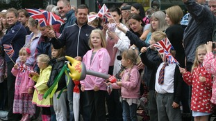 Around 30,000 people lined the route to welcome the Olympic Flame to Rayleigh