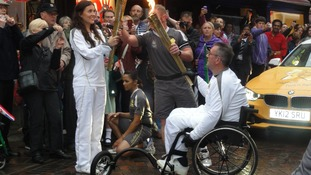 Kevin Curtis carrying the Olympic Torch through Ipswich this morning
