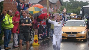 Olympic Torch being carried through a rainy Hatfield Peverel, Essex