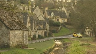 Bibury with yellow car