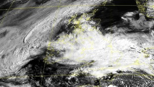 A satellite image showing clouds covering Great Britain as a severe flood warning was issued.