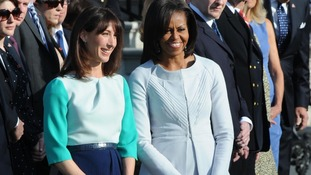 amantha Cameron and Michelle Obama smile on for pictures together on the White House lawn.