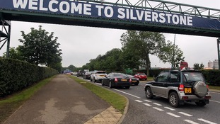 Cars queue to get in to Silverstone Circuit for qualifying for the British Grand Prix.