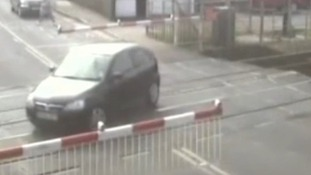 Car in danger at level crossing
