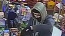 Police have released images of a man they want to speak to after a shop robbery