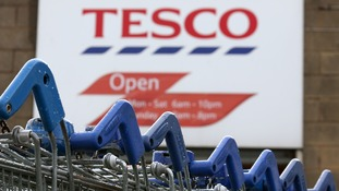 Tesco has agreed to pay settlements to two former executives.