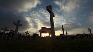 Crosses are seen during sunset at Vukovar Memorial.