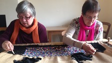 Volunteers at Wordsworth House making a traditional 'proddy' rug using rags