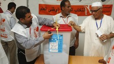 Libyans count votes after the polling station closed in Tripoli